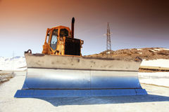 Snow-cleaning bulldozer Stock Image