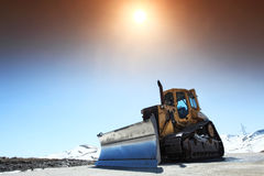 Snow-cleaning bulldozer Stock Images