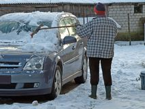 Snow cleaning from car 2 Stock Images