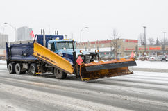Snow Cleaning equipment during a snowfall in Toronto Stock Image