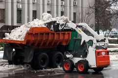Snow cleaning machine on the streets of the city Royalty Free Stock Image