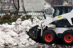 Snow cleaning machine on the streets of the city Stock Photography