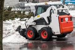Snow cleaning machine on the streets of the city Royalty Free Stock Photography