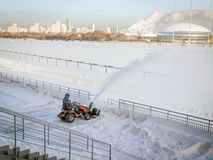 Snow cleaning. By snow-removing equipment Royalty Free Stock Photography