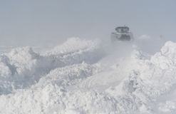 Snow cleaning on the road after a blizzard Royalty Free Stock Photography