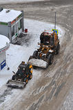 Snow cleaning on roads by means of special equipment. Stock Photo