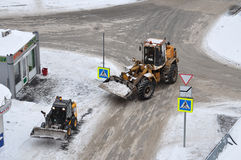 Snow cleaning on roads by means of special equipment. Royalty Free Stock Photography