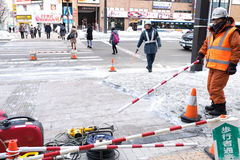 Snow cleaning. SAPPORO, JAPAN - FEBRUARY 2015: staff cleans footpath from snow on February 5 in Sapporo. Cleaning snow at the first day of Sapporo snow festival Royalty Free Stock Photos