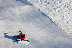Snow Cleaning on Ski Slopes. Ski slopes maintenance on the mountains in the Swiss Alps royalty free stock image
