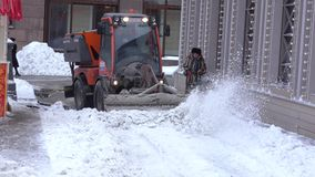 Snow cleaning tractor. MOSCOW, RUSSIA - FEBRUARY 09, 2018: Tractor cleaning up the street after the night snowfall in February 2018 in Moscow Russian Federation stock video