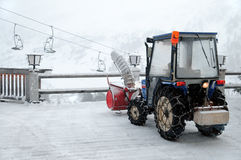 Snow cleaning tractor on ski resort Stock Images