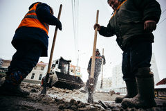 Snow clearance workers. Russia, city Ufa - Febrary 21 2016. Royalty Free Stock Photo