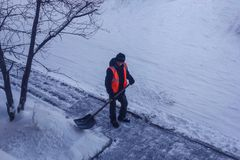 Snow clearance in the yard. stock photography