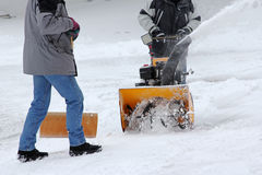 Snow clearing with the snow cutter and snow shovel Stock Photo