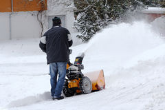 Snow clearing with the snow mill Stock Photos