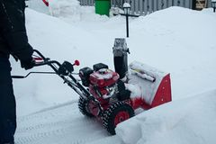 Snow clearing. Snowblower clears the way after heavy snowfall royalty free stock photo
