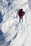 Snow climber. Mountaineer climbing a dangerous wall of snow Royalty Free Stock Photography