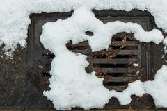 Snow clogged street drain. Snow clogging a street drain Royalty Free Stock Photography