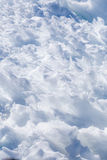 Snow close-up. Close up of snow clods on the track of the avalanche in the mountains Royalty Free Stock Image