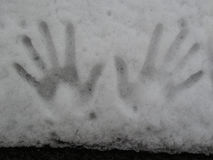 Snow close-up. The imprint of the hands on the white snow Royalty Free Stock Photo