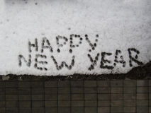 Snow close-up. The inscription on the snow Happy new year Stock Photos