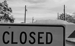 Snow on a closed Sign. Snow on a sign high contrast scene Royalty Free Stock Images