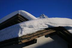 Snow cloth. Roof covered with snow in Maloja, Switzerland Royalty Free Stock Photos