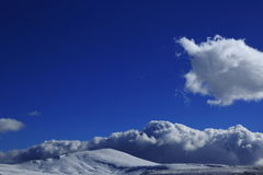 Snow and clouds landscape Stock Photography
