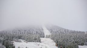 Snow and clouds obscure the view on the mountain Hovaerken in Sweden Royalty Free Stock Photos