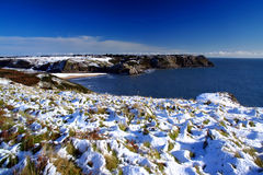 Snow on the coast. Three cliff bay in the gower peninsula (south wales UK) after a november snowfall stock images