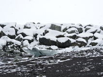 Snow coated boulders. Royalty Free Stock Images