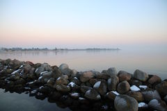 Snow coated stone pier so lovely Stock Photography