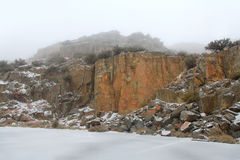 Snow coating on the rocks Royalty Free Stock Photo
