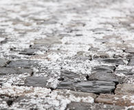 Snow on the cobblestones, soft focus Royalty Free Stock Photo