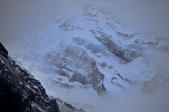 Snow cold Himalayan peaks in fog Royalty Free Stock Photography