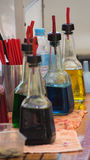 Snow cone syrup bottles. Several snow cone bottles used in a snow cone shop. These bottles can be made of plastic or glass and are all refillable with syrup for Stock Photography