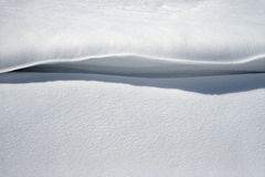 Snow cornice. Cornice of snow caused by blowing snow royalty free stock photo