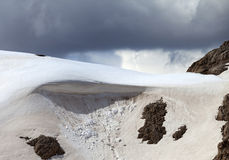 Snow cornice in mountains. Close-up view. Royalty Free Stock Photo