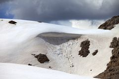 Snow cornice in mountains Royalty Free Stock Images