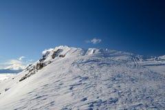 Snow cornice on the ridge Stock Image