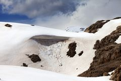 Snow cornice in spring mountains Royalty Free Stock Photos