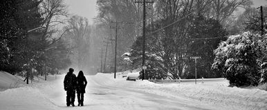 Snow Couple. A couple walking Royalty Free Stock Photography