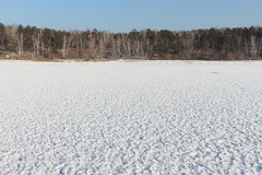 Snow cover of a freakish form on ice of the frozen river Stock Photography