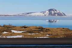 Snow cover mountain background over the lake winter. Season, Iceland winter landscape background Royalty Free Stock Images