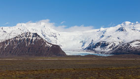 Snow cover mountain with clear blue sky. Natural landscape background, Iceland Royalty Free Stock Image
