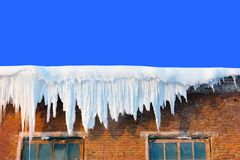 Snow cover on roof. Of old textile fabric with icicles royalty free stock images