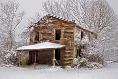 Snow covered abandoned house. With surrounding trees Stock Photos