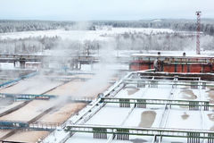Snow-covered water tanks in sewerage treatment plant Royalty Free Stock Image