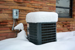 Snow Covered Air Conditioner on a Cold Winter Day Stock Photos