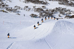 Skier racing through a Ski Cross Course in Australia. Skier racing and jumping through a Ski Cross Course - racing against the clock in the Australian Alps Royalty Free Stock Images